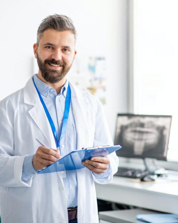 mature-dentist-in-modern-dental-surgery-looking-at-camera.jpg